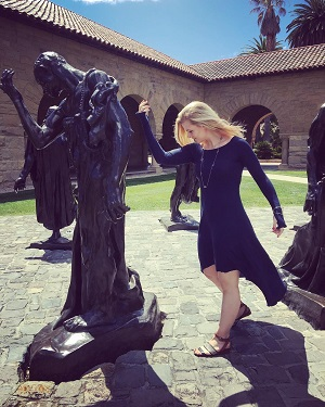 Madi posing with Auguste Rodin's 'The Burghers of Calais' at Stanford University